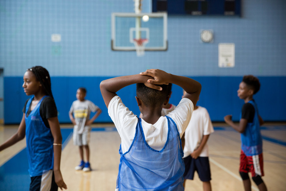A participant tries to catch his breath during the seventh annual P.R.O.M.I.S.E. youth basketball camp with Jakim Donaldson on Thursday, July 27, 2017 at Perry High School in Pittsburgh's North Side. Jakim's father, Jay Donaldson, started P.R.O.M.I.S.E., an organization that works to reduce gun violence, after his son, Jehru Donaldson, was shot and killed in 2007 during an attempted carjacking while on his way to pick up his girlfriend's nephews to take them to a Pirates game.