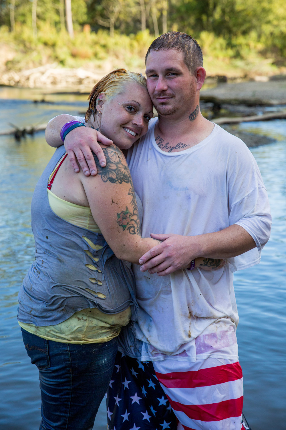 Whitney Johnson and Jeremy Rhoades pose for a portrait after Jeremey's baptism. Whitney was baptized in the same spot along the river near old route 33 in Nelsonville just over a year prior.