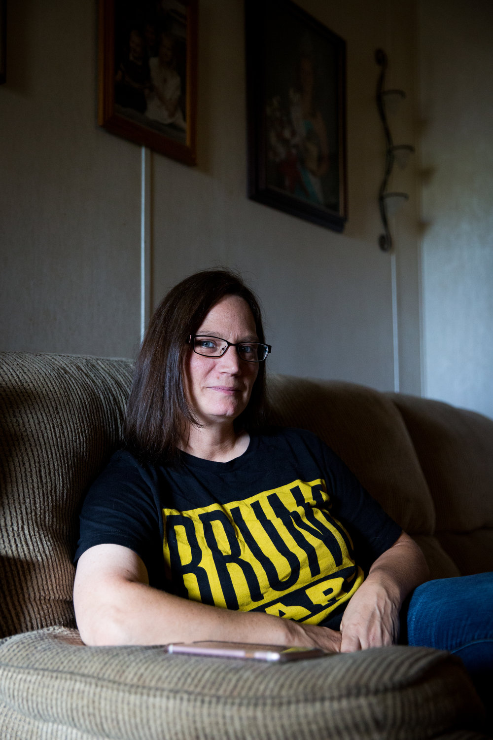 Missy Mullins poses for a portrait in her living room in Logan. Missy's son is addicted to heroin and meth, and she has struggled to find support for family members dealing with a loved one's addiction.