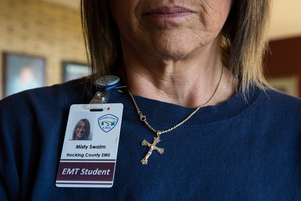 Misty wears her badge and crucifix necklace with her uniform. Misty's main goal is to help people, especially addicts and the homeless.