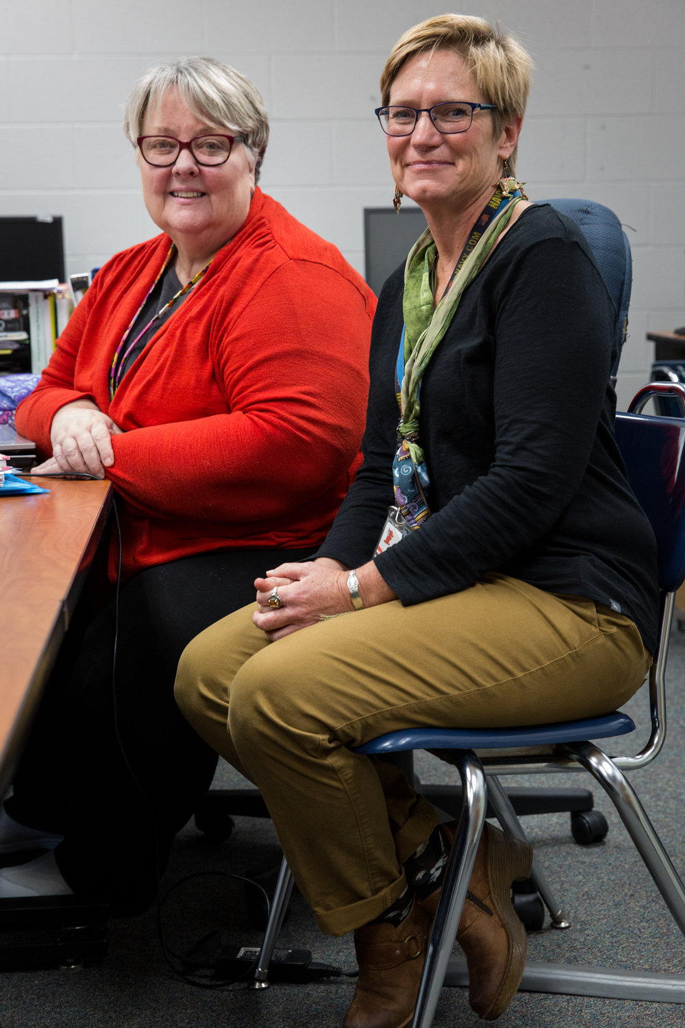 South Webster High School teachers Judy Ellsesser, left, and Cyndy Hykes, right, pose for a portrait in Judy's classroom. The pair designed a class for their junior students to learn about the opioid epidemic. The students read the book Dreamland by Sam Quinones, listen to speakers involved with the epidemic, and work on a project to give back to their community.