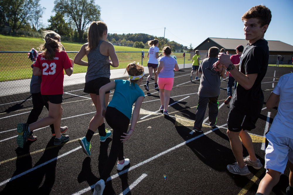 Mason, right, helps to lead a running club for students in the after school program. Many of the students aren't involved in extracurricular activities, and they find an outlet through the program.