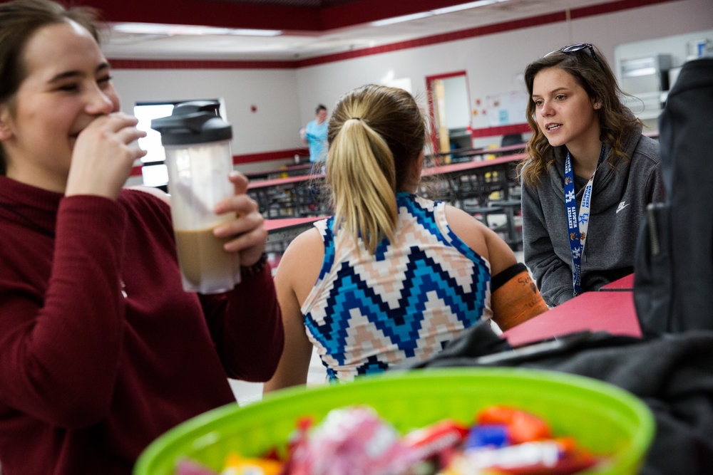 Lexi, right, a junior at South Webster High School talks to her fourth grade buddy, Jasmine, during an after school program at the elementary school. The program is designed for at risk students, and some juniors in the opioid epidemic class have paired up with those younger students for their project.