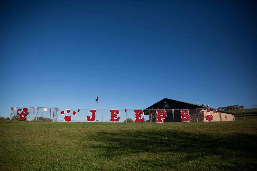 The name of South Webster's mascot decorates the fence surrounding the track where the running club runs laps after school.