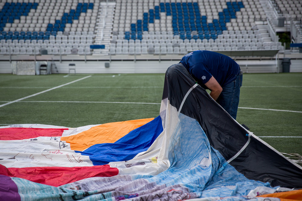 Bill Baker of Dallas sets up the DreamShip, a hot air balloon, sponsored by the Rite Aid Foundation's KidCents program and Folds of Honor, that is made up of over 400 panels designed by children who are Folds of Honor scholarship recipients, on Friday, August 4, 2017 at Highmark Stadium in Pittsburgh.