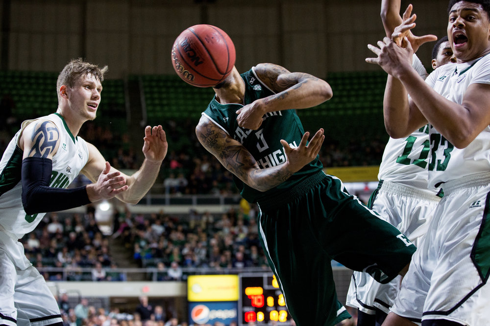 Ohio's Treg Setty waits to catch a pass missed by Eastern Michigan's Raven Lee during a men's basketball game on February 7, 2015, in the Convocation center in Athens, Ohio. Ohio finished the consistently close game ahead with a score of 76-73.