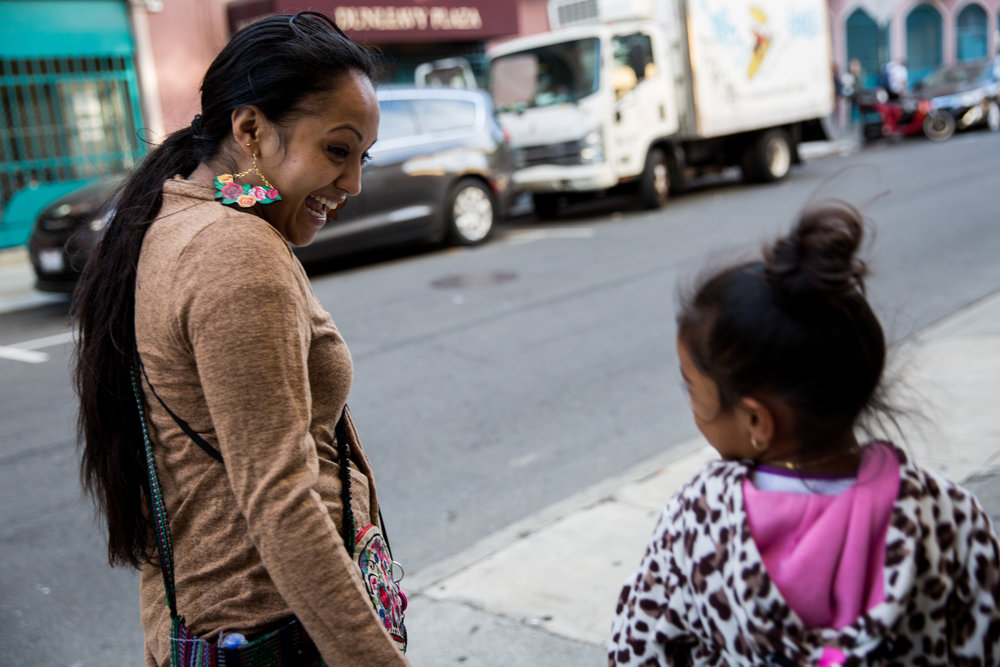 Julia Arroyo walks to the park with her daughter Guillermina, who she calls Baby G, after picking her up from school, where it was pajama day. Julia's daughter was one of the driving forces that helped her push herself to become the version of herself that she wanted to be.