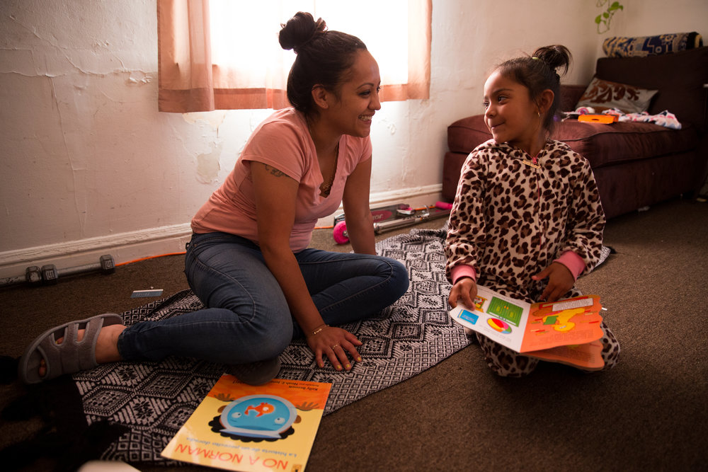 Guillermina reads a series of books to her mom after getting home for the day. Julia doesn't speak Spanish and wanted her daughter to have a second language, so she enrolled her in an immersion school. Guillermina was frustrated that she had only learned to read in Spanish at school, so she taught herself how to read English.