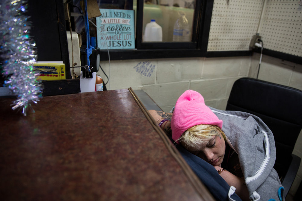 Whitney sleeps at her desk at JR's Transmission. Whitney was putting in long hours at the shop and hadn't been sleeping much.