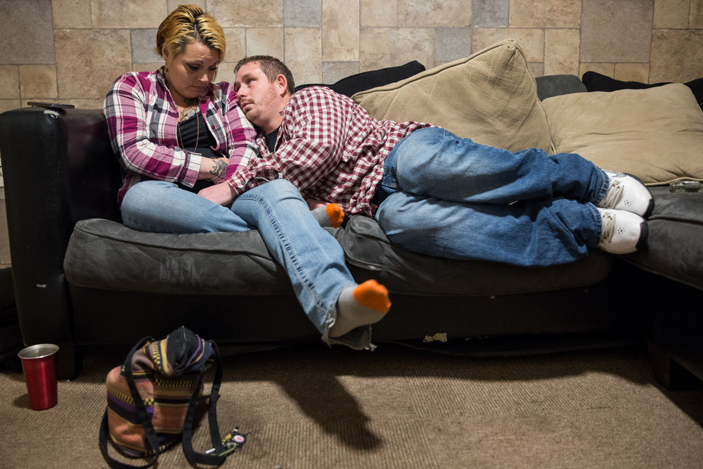 Whitney and Jeremy sit on the couch after an argument. Whitney was angry with Jeremy for getting sent to the sober house and leaving her alone, which sparked more fights than normal in their relationship.