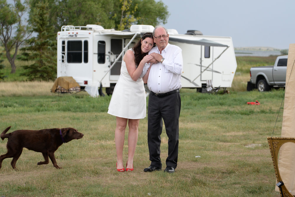 "The moment before the Father-of-the-bride walked his daughter down the aisle with of course ""Gidget"" the family's dog"