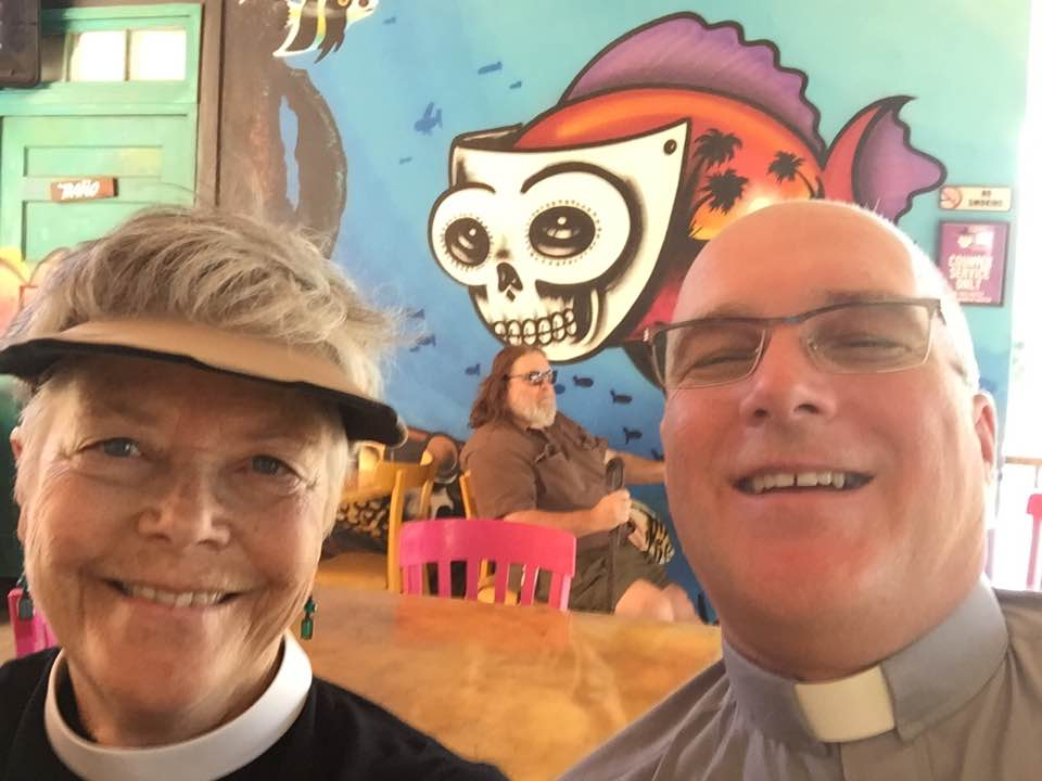 "Protest buddies, Rev. Delle McCormick and Rev. Randy Meyer  'After last night in Phoenix I know better the meaning behind ""When Jesus saw the crowds his heart broke."" (Mt. 9:36) But it was from his broken heart that his passion for and commitment to peace with justice grew.' - Rev. Delle McCormick"