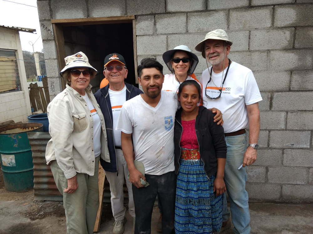 Volunteers Judith, Dennis, Sue, and Glenn with Isreal and Jessica in front of their new home.