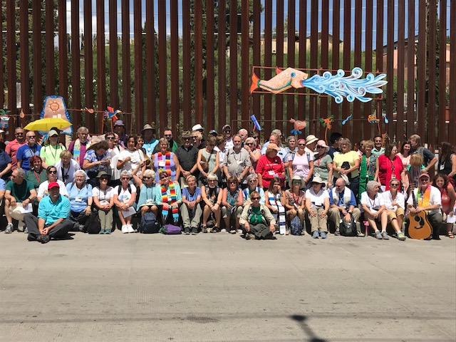 entire group at border wall - by ucc.jpg