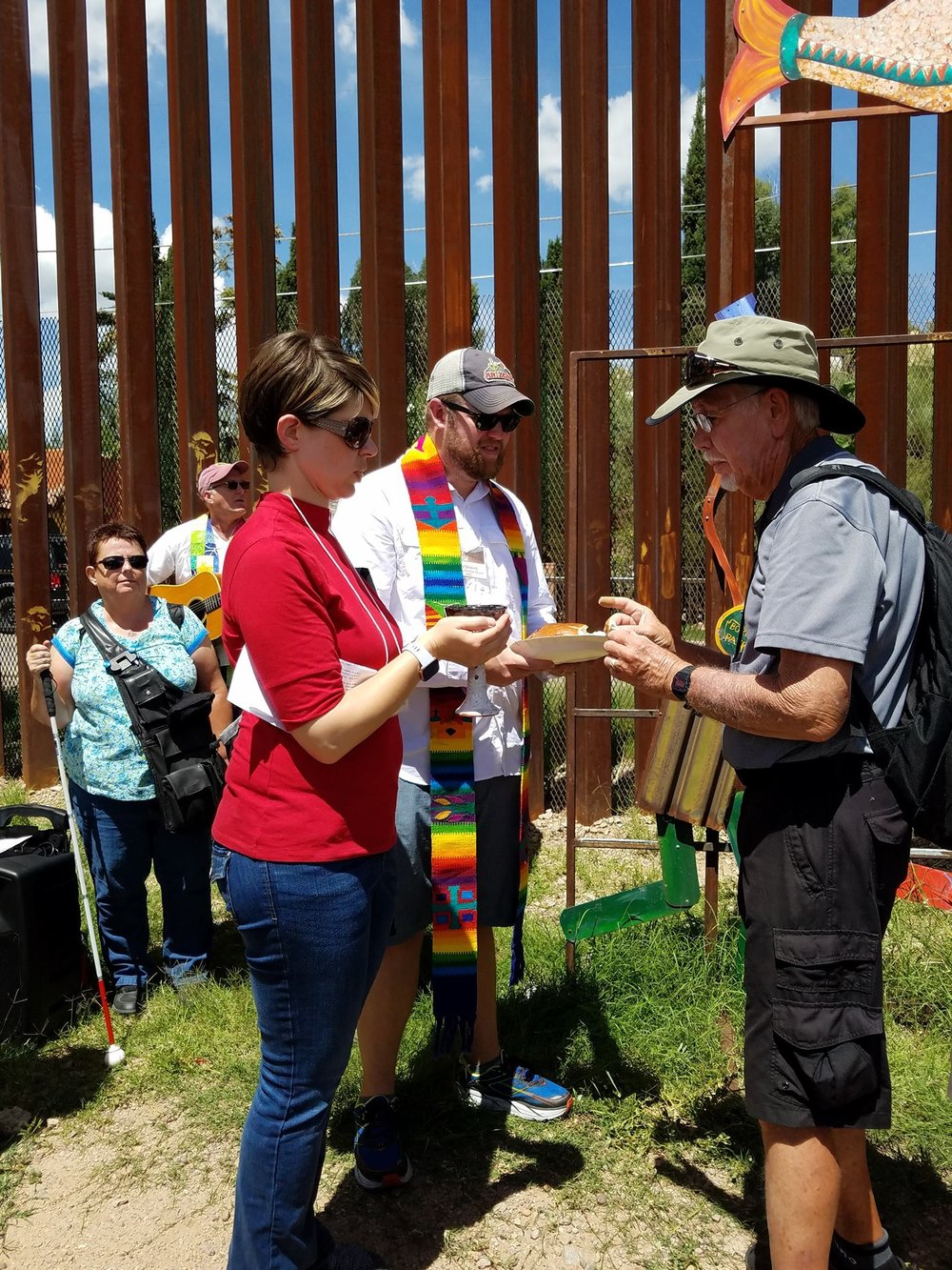 communion at the border wall by rebecca dickinson.jpg