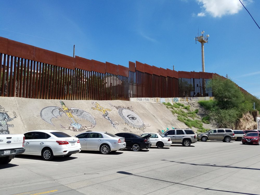 parking lot at border wall by rebecca dickinson.jpg