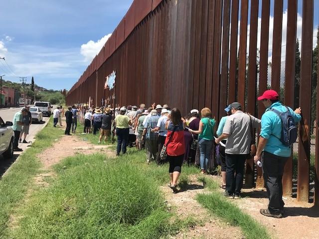 GSUCC Delegation at the US Mexico border saying prayers.jpg