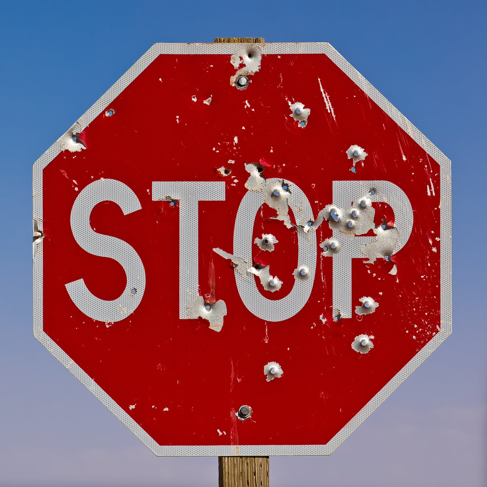stop sign bullet holes.jpg
