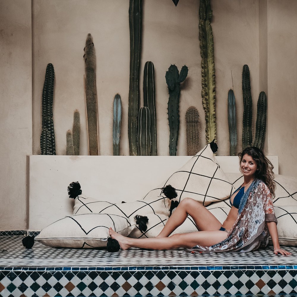 "Elyssa - NY, NY | Morocco 2018 + Barbados 2017   This was my second trip with Fitness + Foolishness and both times they absolutely killed it. The accommodations were incredible. We had the entire Riad, with two gorgeous pools and rooftop, to ourselves. I am still dreaming of the breakfasts we were served each morning - fruit and orange juice, yogurt with granola, bread, pastries, and eggs, all incredibly fresh. The hospitality we were given from the staff at the riad was unlike any service I have had before.  Luckily, I never felt guilty about eating all of the bread and tagine because we had fitness classes almost every morning and evening. If you have ever taken a pilates class with Nicole, you know she never fails to make your abs and booty burn. HIIT and yoga classes also added a nice variety for people who prefer more cardio or more stretching. All classes were totally optional and no one was every judged about missing a class (or every class if they wanted).  We had enough free time to explore the city on our own, but Nicole and Marisa planned some great outings. Most memorably, the glamping excursion. This was unreal. We got to ride camels during the sunset and hang out all night by the campfire in the most glamorous setting (seriously the definition of ""glamping""). We also got hammams, which were included in the package and a final group dinner.  I am truly a F+F addict and would go on every trip if I had the vacation days and money. It is clear Nicole and Marisa put an immense amount of thought into each trip and truly care about making it a unique and enjoyable experience for everyone on the trip. - Elyssa S. NYC, Morocco 5.18"