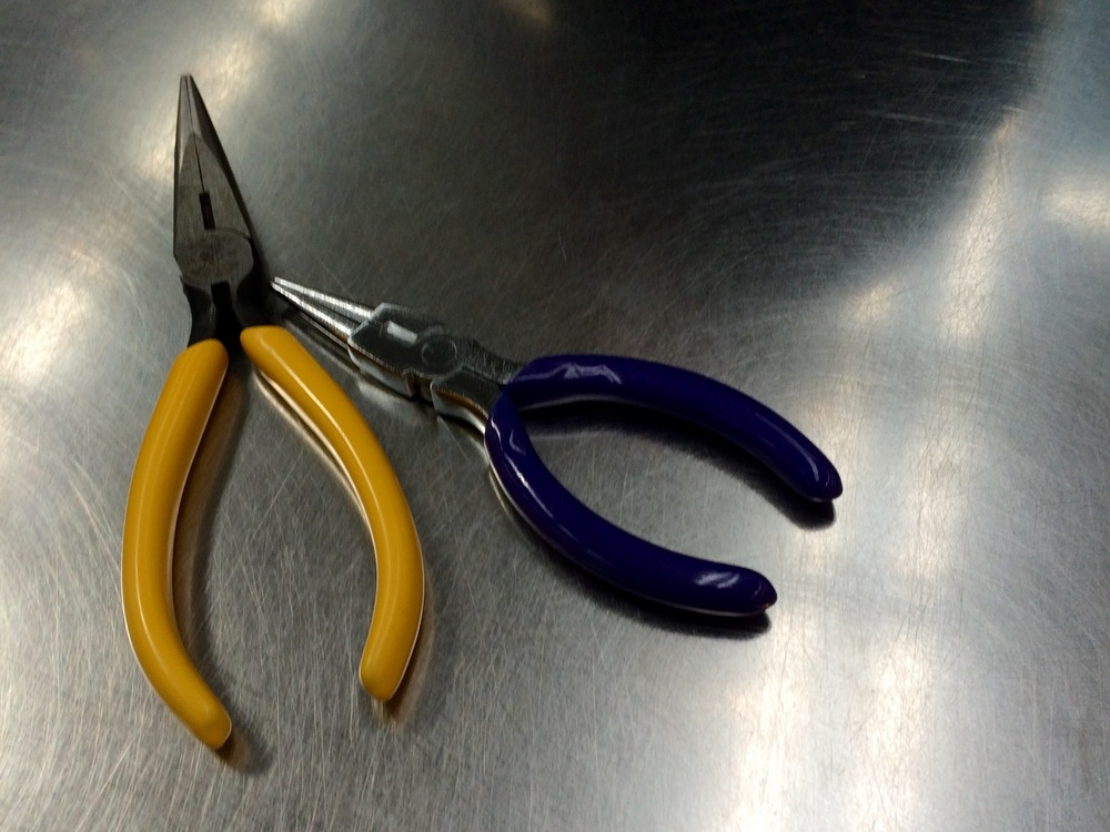 My first pliers on this project, now in a trash bin at London Heathrow
