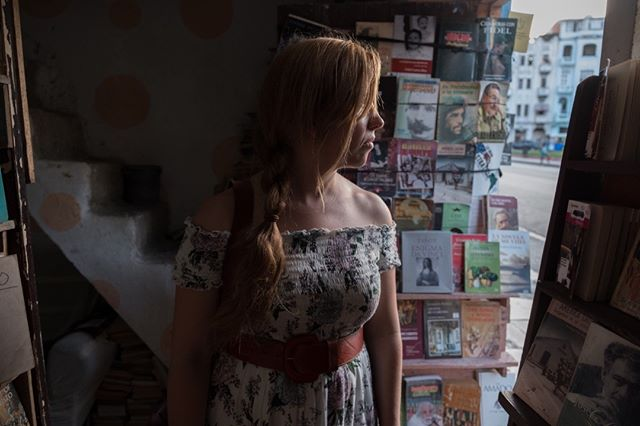 Stepping into a small book store on the front porch of a woman's home in Centro Habana.