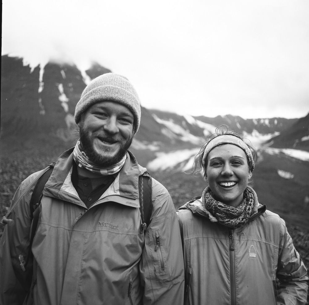 "Kevin and Sandra, Portraits in the Wild. Moments prior to this photo, we had been digging in the ground on the glacier to uncover debris and measure how deep the debris above this ""dirty"" part of the glacier was. Kevin is a bar tender, and Sandra is a glaciologist in training. Together our rag tag group was generating valuable information that tells the story of a changing glacier. August 2015. PanF+, Hasselblad 500C/M, 50mm Distagon."