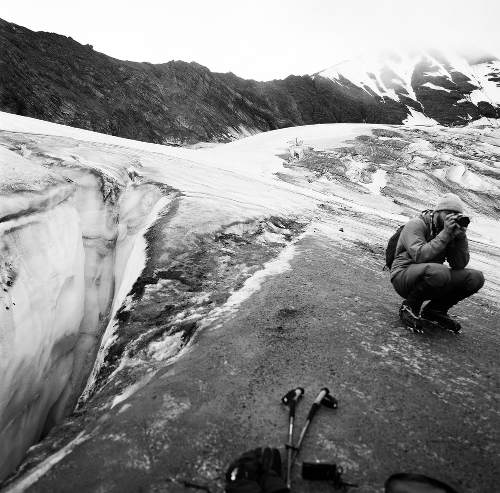 Kevin Slotemaker is a bartender, a comedian, and someone who cares about the planet. Here Kevin sits mere meters away from a large crevasse on the Middle Fork Toklat Glacier, adding his photographic styles to help tell the story of a changing world. Yet another soul who didn't go to school to become a scientist, but someone who wants to help regardless. August of 2015. PanF+, Hasselblad 500C/M, 50mm Distagon.
