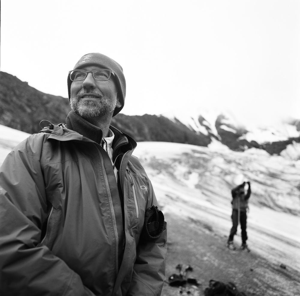 "Rob Burrows, a glaciologist working at Denali National Park. Rob has had the foresight to expand Citizen Science efforts, and bring others along to gather data and help tell the story of this changing world. Affectionately known as ""Robopop"" by us, he patrols the glaciers trying to keep them safe. August of 2015. PanF+, Hasselblad 500C/M, 50mm Distagon."