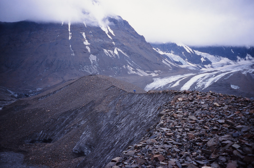 Kevin walks the ridge of the tongue of the Middle Fork Toklat Glacier, as he makes his way back from taking measurements with Sandra and I. This was such a small area of the glacier but gives a feeling of the immense scale we are dealing with, even with tiny glaciers, which the Middle Fork Toklat is. August of 2015. Velvia 50, Olympus Stylus.