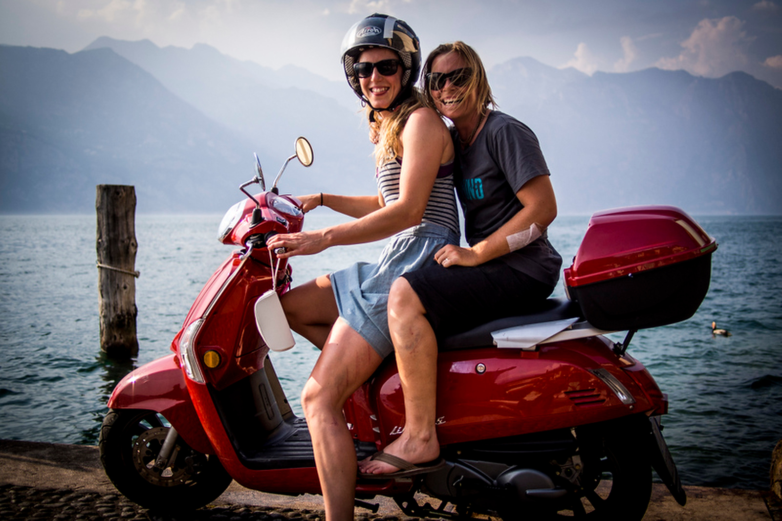 Exchanging bikes for scooters for some lake cruising with Rach.