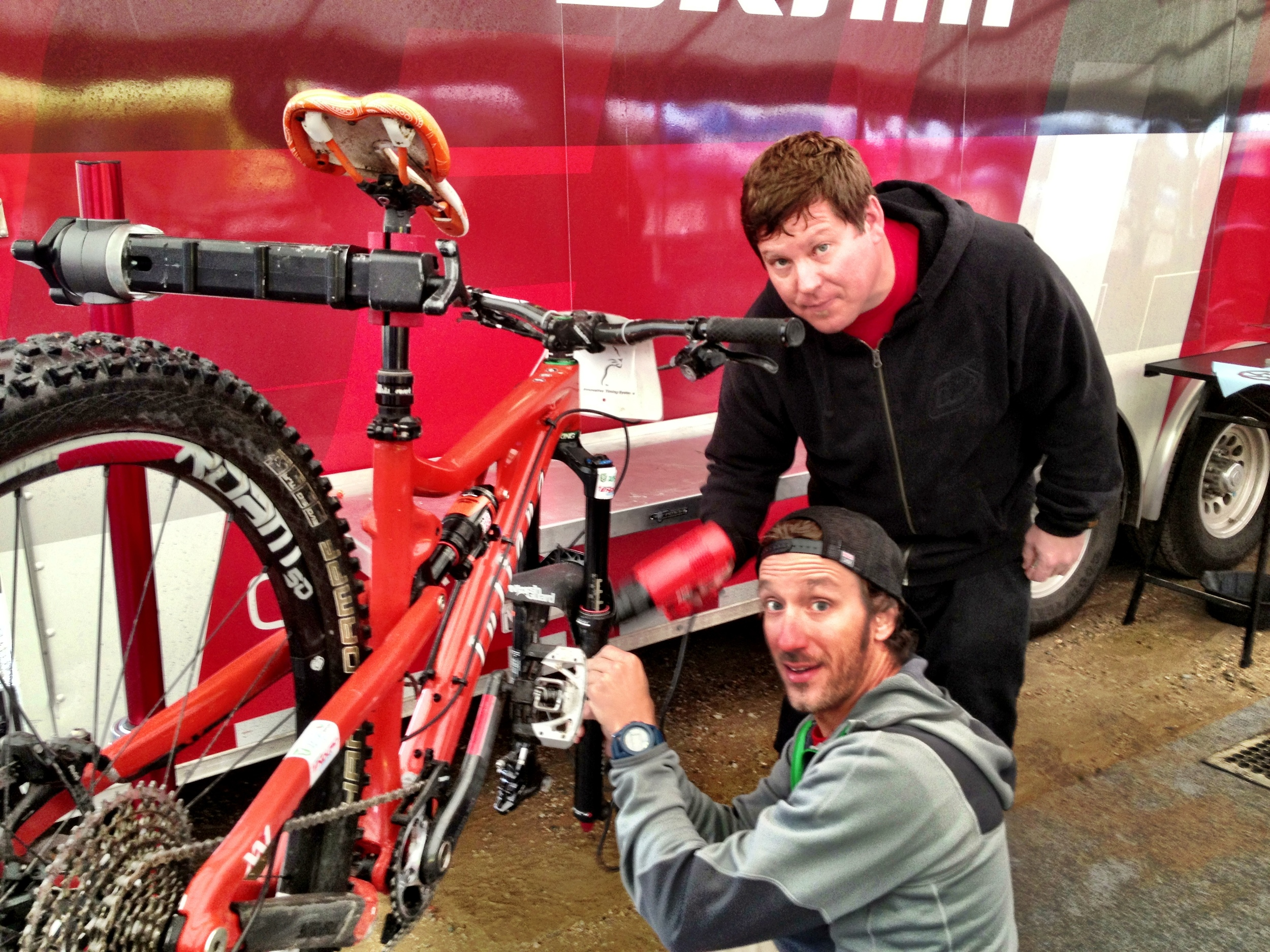Jon C & John D having fun with the heat gun & treating me bike with some matching decals.