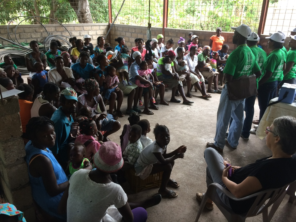 Community health workers discuss vaccination and nutrition with women in Terre Neuve, Haiti. (Laura Payton)