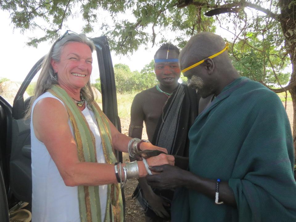 Admiring Jean's bracelets in Ethiopia