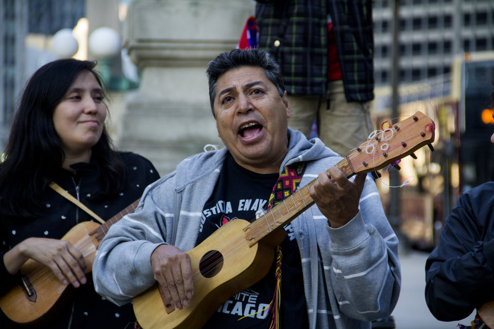Manuel Macias leads music before the rally begins.