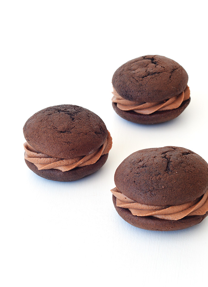 My favourite Chocolate Whoopie Pies filled with creamy Nutella Frosting!