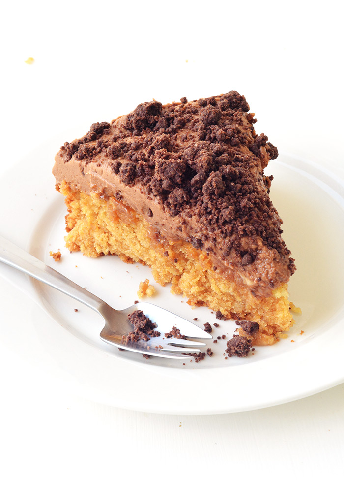 Peanut Butter Poke Cake with creamy chocolate frosting and homemade chocolate crumbs | Sweetest Menu