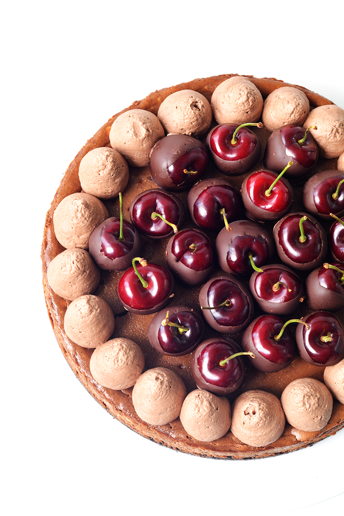 MBaled Black Forest Chocolate Cheesecake with an Oreo crust and chocolate-dipped cherries | Sweetest Menu