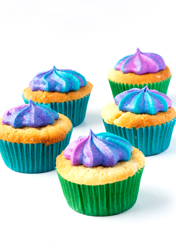 Perfect Vanilla Cupcakes with Swirled Rainbow Frosting | via sweetestmenu.com