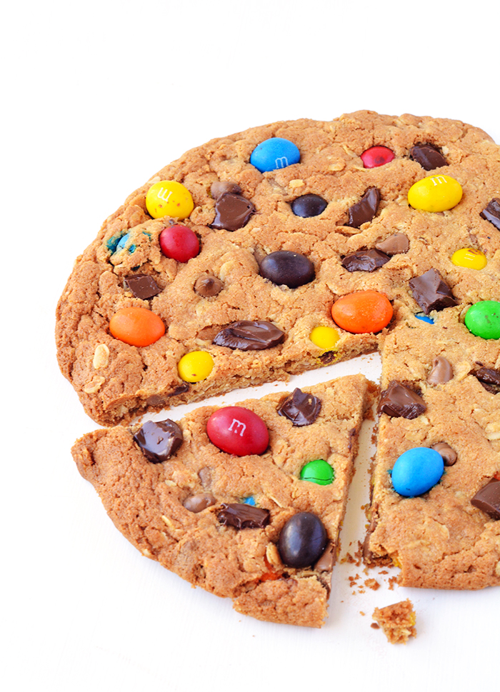 Learn how to make just One Giant M&M Monster Cookie | via sweetestmenu.com