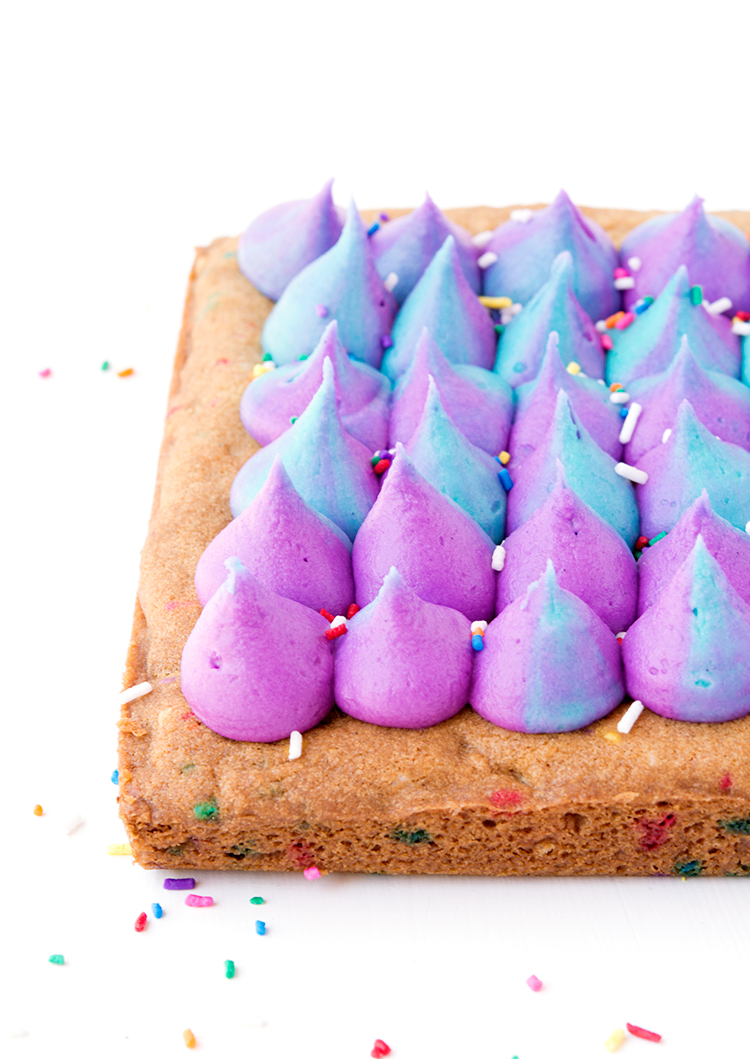 Unicorn funfetti cookie bars with coloured buttercream and sprinkles | recipes via sweetestmenu.com