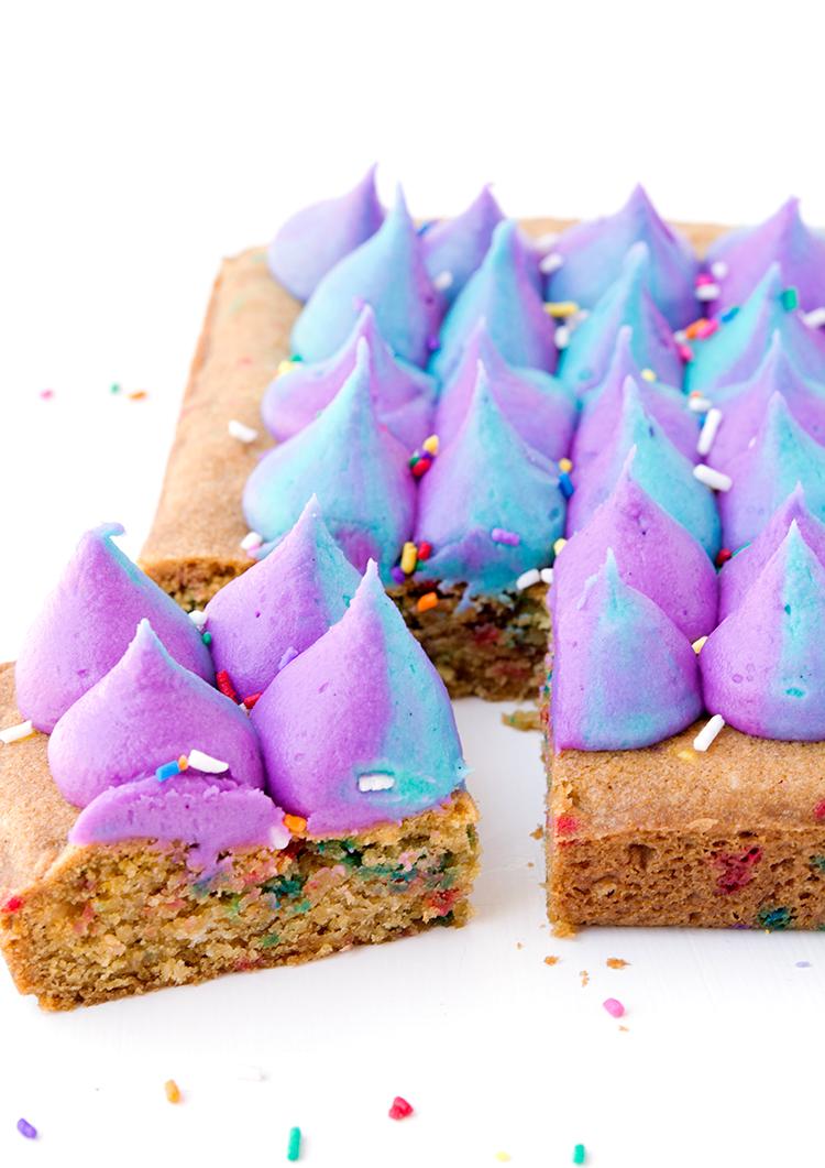 Unicorn funfetti cookie bars with coloured buttercream and sprinkles | recipes via sweetestmenu.com