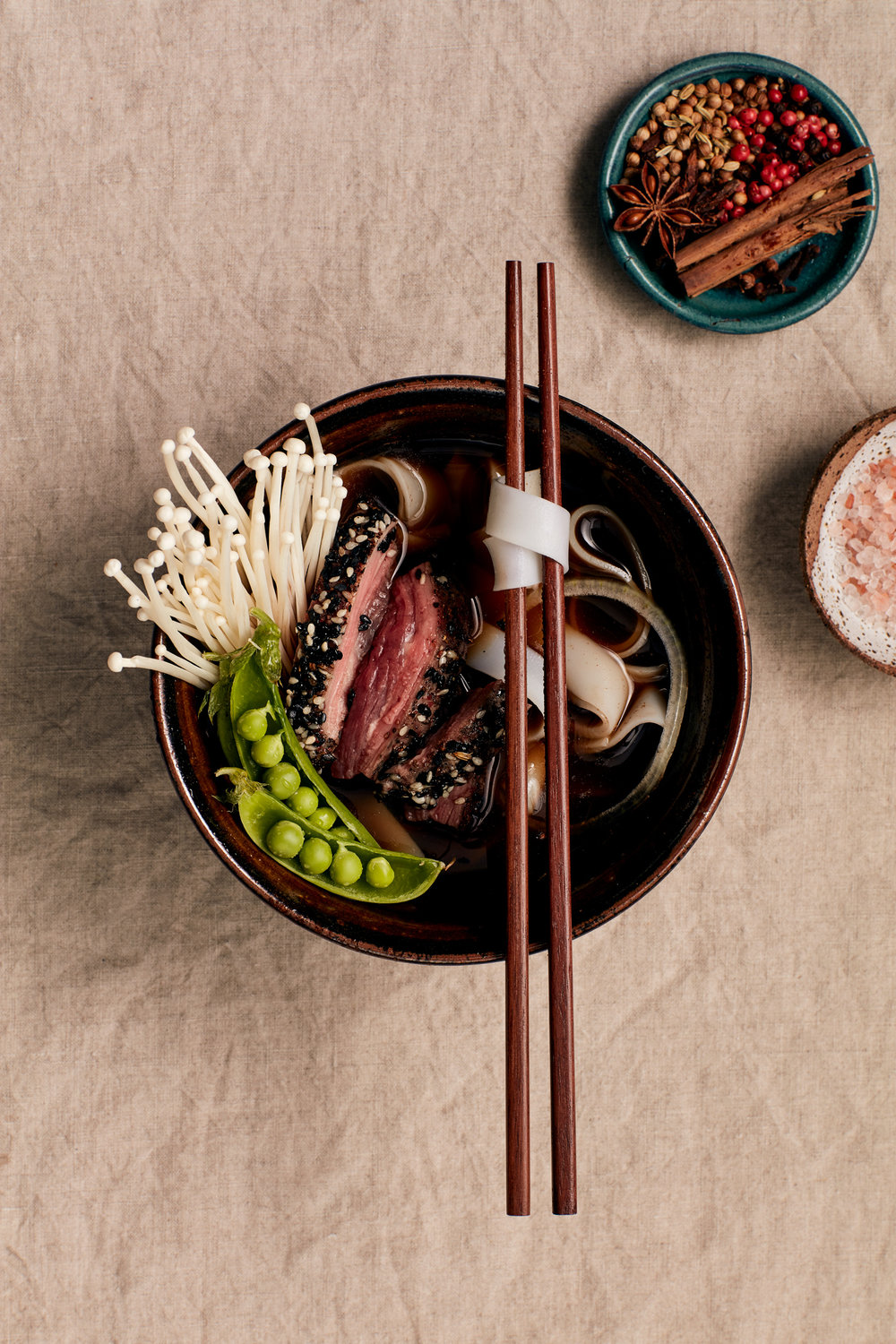 SESAME-CRUSTED BEEF PHO [ART DIRECTION + STYLING] PHOTOGRAPHY BY NIC GOSSAGE