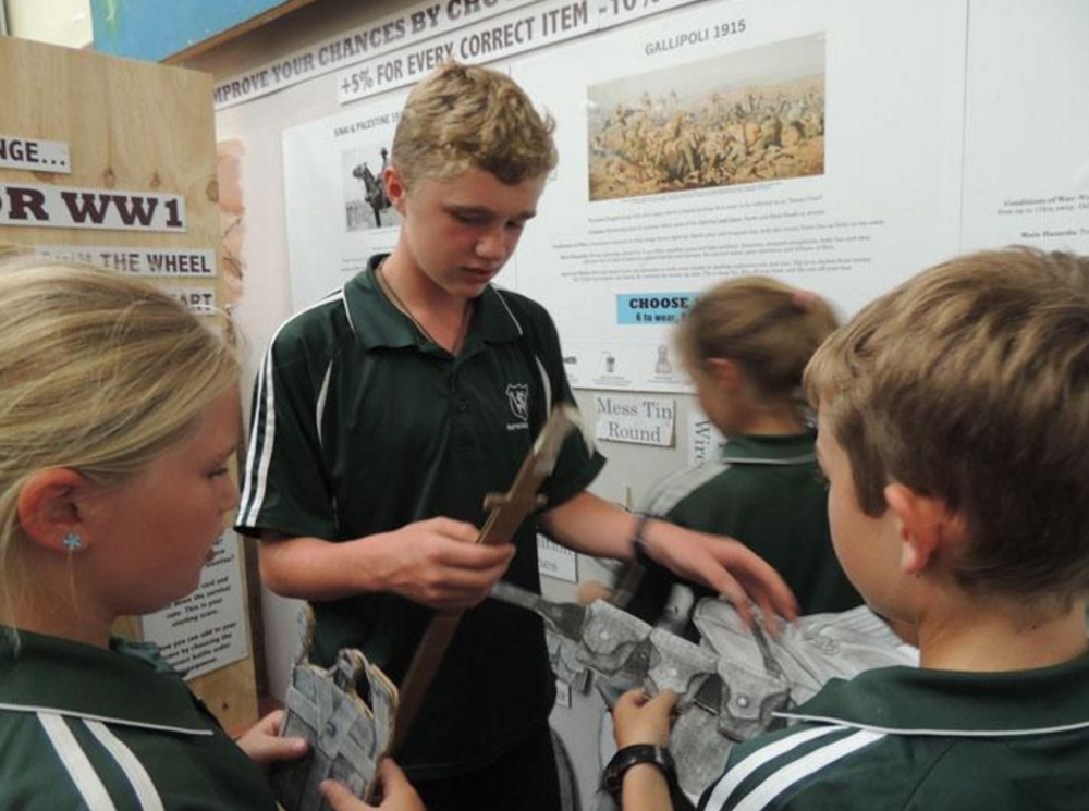Students working together to select battle order equipment for the Survivor WW1 interactive at the Central Hawke's Bay Settlers' Museum.