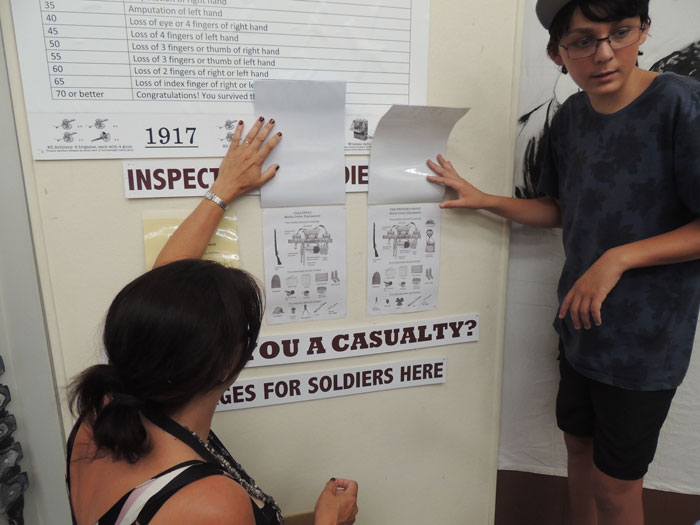 A family scores their soldier's equipment.