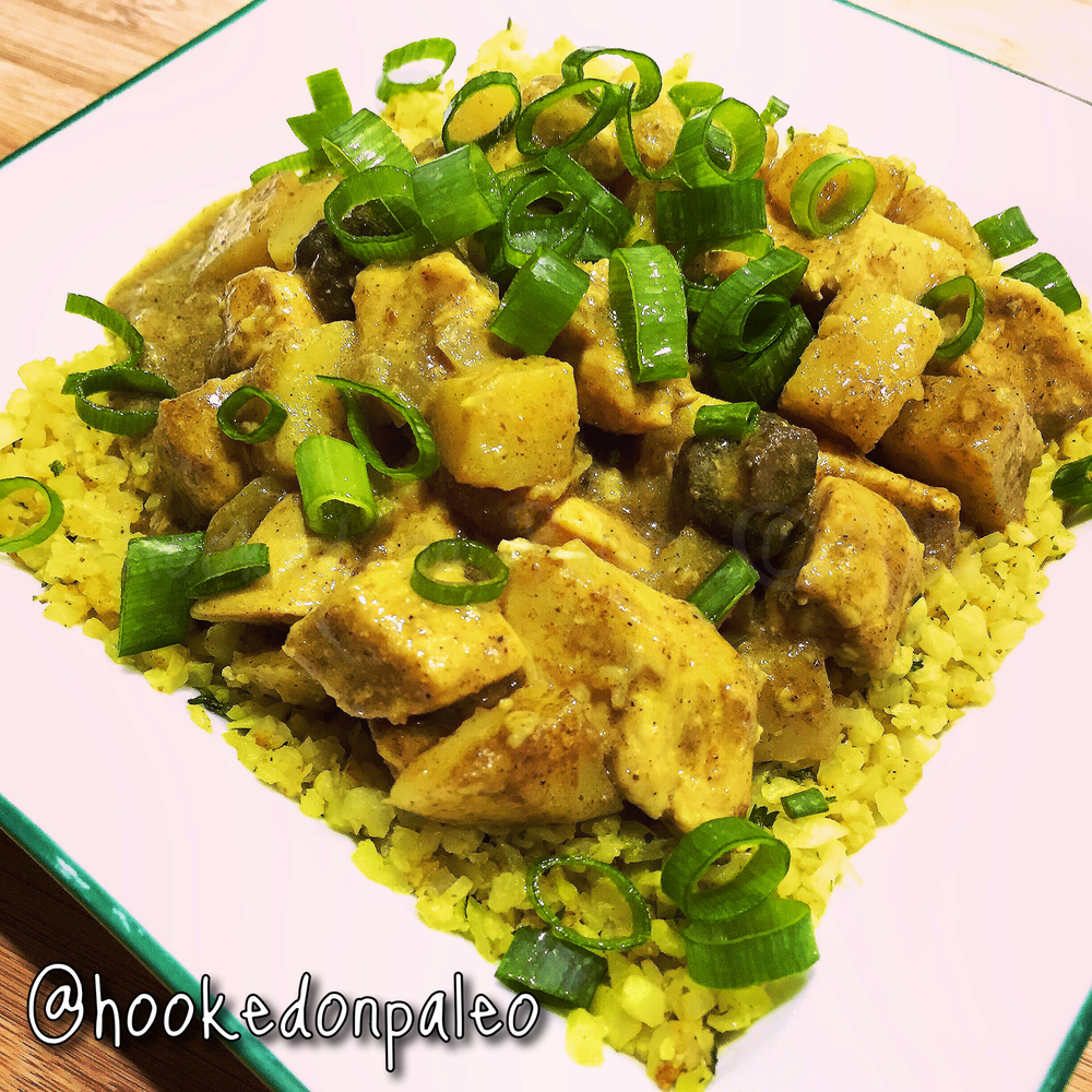 This chicken curry is accompanied with curry cauliflower rice