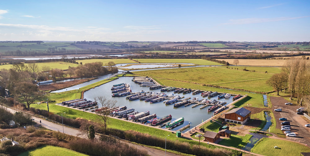 white_mills_marina_aerial_narrowboats_cruising_river_nene
