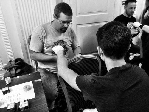 Chris wrapping his fighter's hands before war.