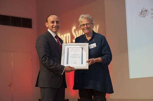 WSLD Patron Kerry Schott presents the corporate philanthropy prize to Karl Bitar from Crown Resorts