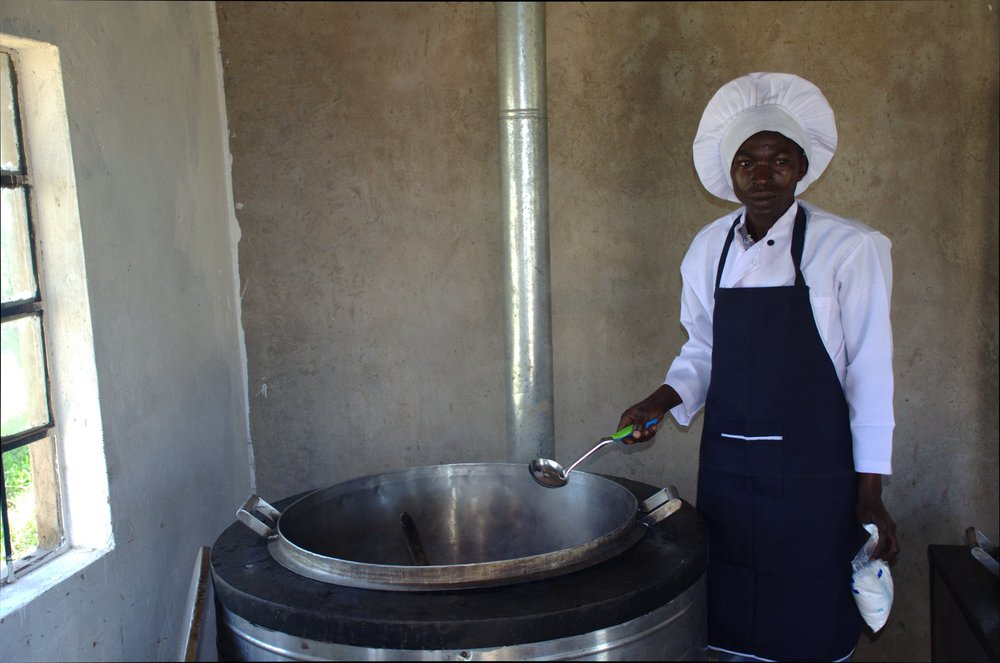 The chef at St. Mary's Girls Primary School in Machakos preparing a meal using an improved energy saving jiko. © David Wandabi