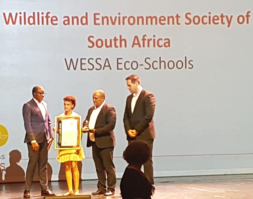 WESSA Eco-Schools  GM, Donavan Fullard and WESSA Programme Manager, Cindy-Lee Cloete as they accept the trophy and certificate.